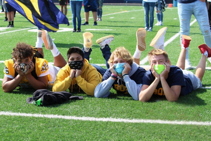 Showing off their mask fashion at the Homecoming Pep Rally are Seniors Christopher Golson with a tie dye Streetsboro mask, Colin Agra with a Nike mask, Tyler Bodovetz with a disposable blue mask and Colin Boldin with a neon yellow mask.