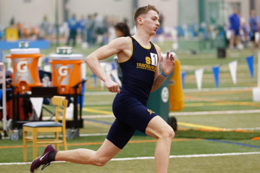 Now+Senior%2C+Ethan+Schuster+running+400m+at+the+OATCCC+Indoor+State+Championship