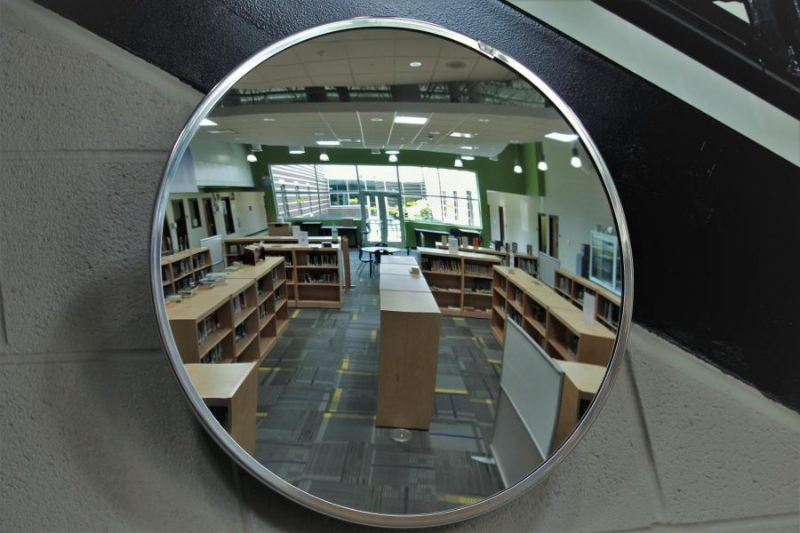 Looking into the mirror you are able to see the wonderful library provided to the students and staff.  The library is always open for you to check out books