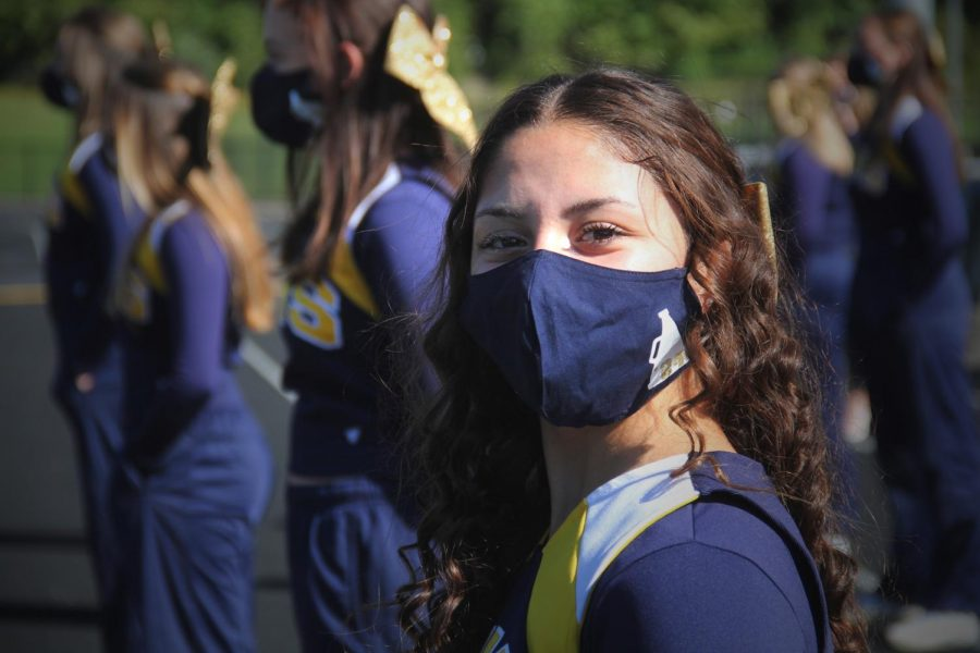 Sobie recently cheering for the football team even through the mask.  Even with the mask on you can see her positivity  and smiling face