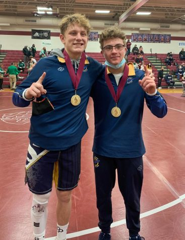 Senior Tyler Bodovetz and sophomore Donovan Paes celebrate their PTC wins. Both later qualified for the state meet.