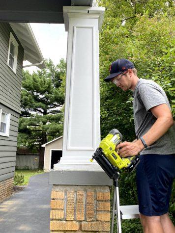Matt Klodor, husband of English teacher Molly Klodor repairs their carport as one of their quarantine projects