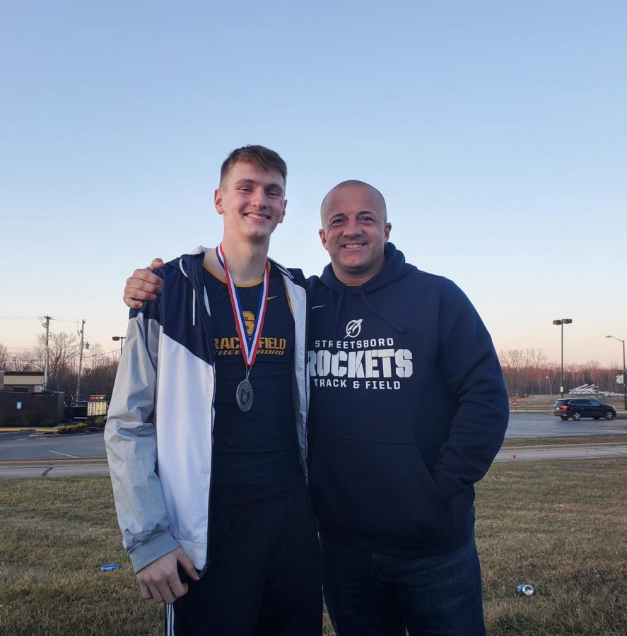 Senior+Ethan+Schuster+and+Track+Coach+Robb+Kidd+celebrate+Schuster%27s++state+runner+up+title+for+indoor+D2%2F3.+He+ran+the+400m+in+49.79.