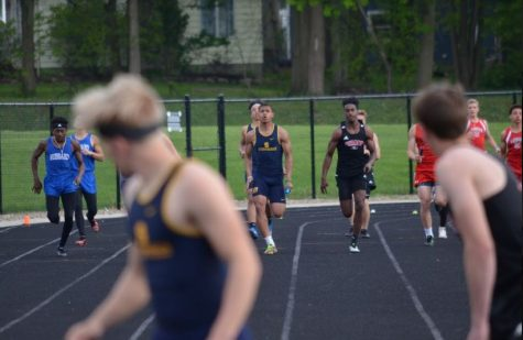 Graduate Cameron Kamlowsky awaits the handoff from senior Donny Washington in a relay run during the 2019 season.