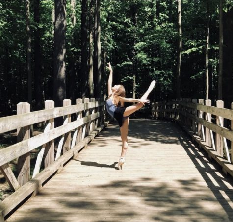 Junior Aspen Hanzak performs an arabesque in the Cleveland Metro parks the summer before 8th grade year.