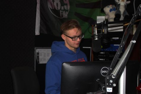 Senior Owen Stiftar serves as the operations manager of 88.9, The Alternation. (photo by Amanda Ruffo)