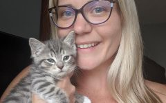 Intervention specialist Louise Milton with one of her fostered kittens.