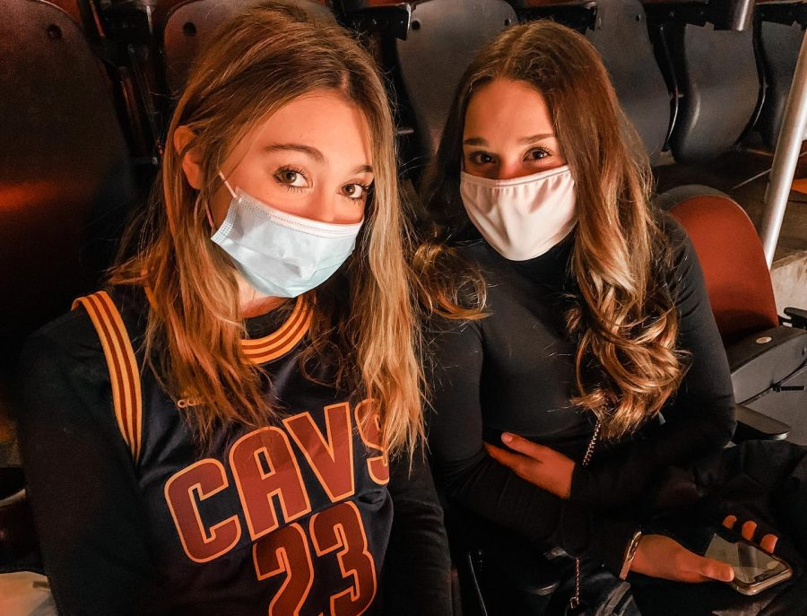 Senior Olivia Rhinehart and sophomore Arai Marino attend a Cavs game. The Cavs are allowing fans, but not at full capacity yet.