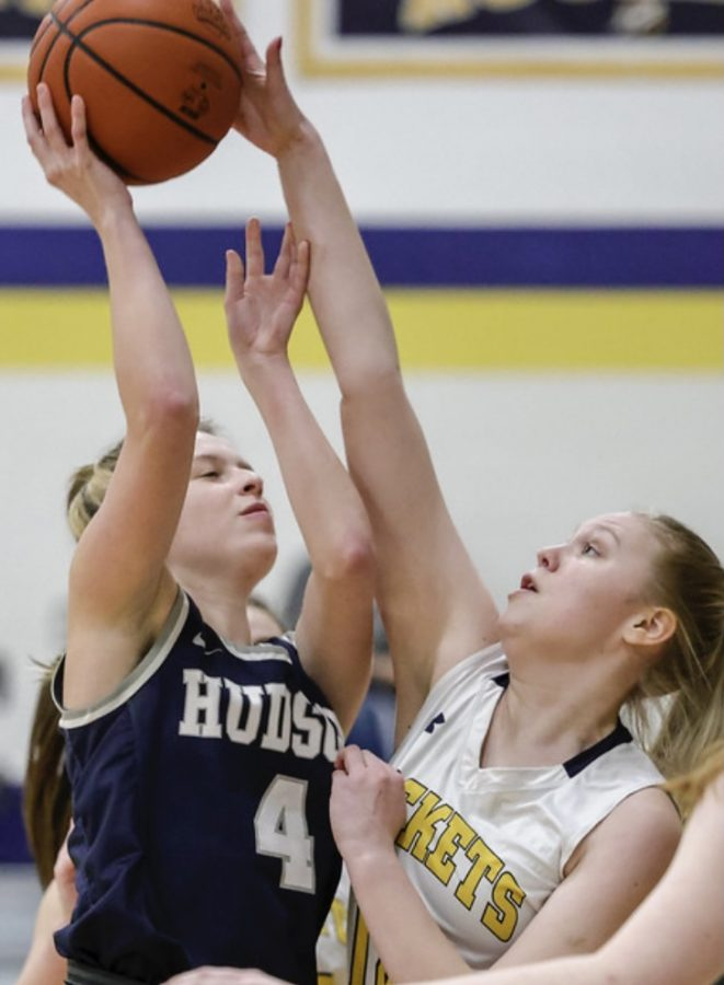 Junior Savanna Estes blocks a Hudson players shot. Estes plays the forward position and has had 2 concussions due to contact in the post.