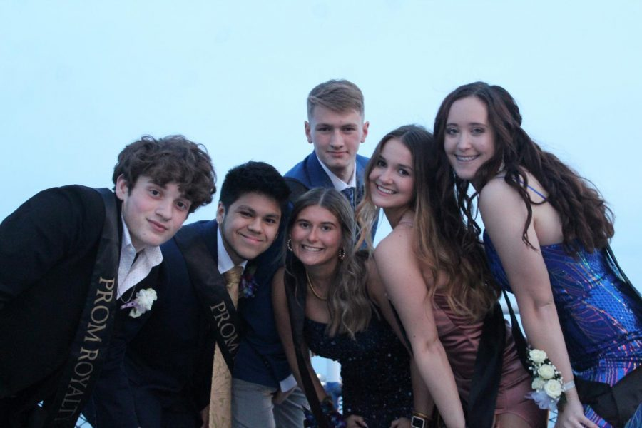 Senior prom court members hang out on the upper deck of the Goodtime III before the announcement of King and Queen. They are Garret Kelly, Colin Agra, Ethan Schuster, Alli Hoffman, Vivian Hall and Kaylee Christine.
