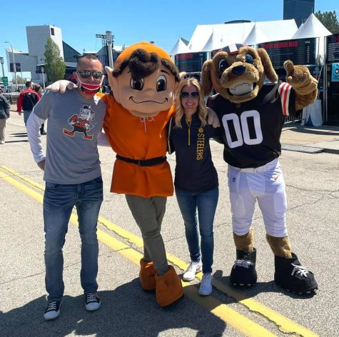 English teacher Megan Rumsey captures a moment at the NFL draft in Cleveland May 1 with her husband, Jeff Rumsey, and the Browns and Steelers mascots.